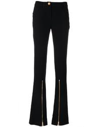 Pantalón de campana negro de Moschino