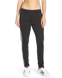 Pantalón de pinzas en negro y blanco de adidas