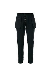 Pantalón de pinzas negro de Unravel Project