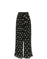 Pantalones anchos a lunares negros de Nanushka