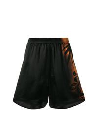 Pantalones cortos con print de flores negros de Maison Margiela