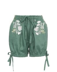 Pantalones cortos de lino con print de flores verde oliva de Innika Choo