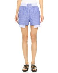 Pantalones cortos de rayas verticales azules de Dion Lee