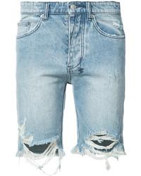 Pantalones cortos vaqueros desgastados celestes
