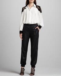 Pantalones de pijama de cuero negros de Alice + Olivia