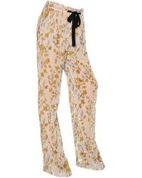Pantalones de seda con print de flores en beige de Etro