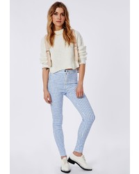 Pantalones pitillo a cuadros en blanco y azul