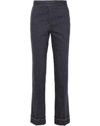 Pantalones pitillo de lana de rayas verticales azul marino