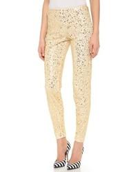 Pantalones pitillo de lentejuelas dorados de Moschino