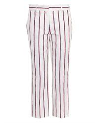 Pantalones pitillo de rayas verticales en blanco y rojo