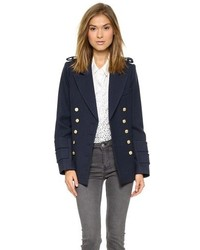 Consider teaming a blue cropped top with a pea coat for a comfortable outfit that's also put together nicely.