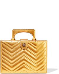 Pochette en cuir matelassée dorée Gucci