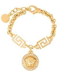 Pulsera dorada de Versace