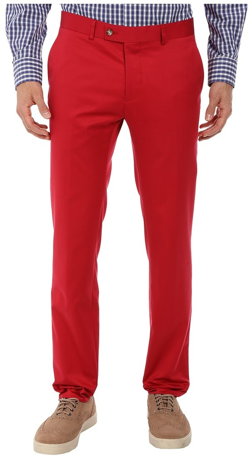 Men's Red Flat Front Dress Pants. A pair of red dress pants is an excellent addition to any pan's wardrobe. These pants can be worn in a huge variety of events and will provide a stylish foundation for a colorful ensemble.