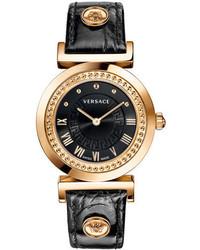 Reloj de cuero con tachuelas en negro y dorado de Versace