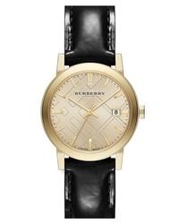 Reloj de cuero en negro y dorado de Burberry