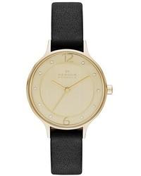 Reloj de cuero en negro y dorado de Skagen
