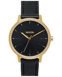 Reloj de Cuero Negro y Dorado de Nixon