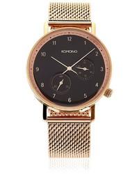 Reloj dorado de Komono