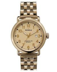 Reloj dorado de Shinola