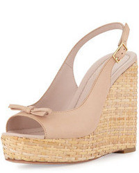 Sandalias con cuña de cuero rosadas de Kate Spade