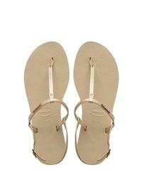 Sandalias de dedo de cuero doradas