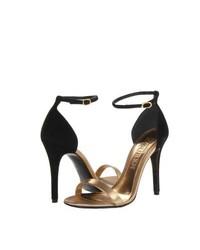 Sandalias de tacón de cuero en negro y dorado