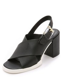 Sandalias de tacón de cuero gruesas negras de Miista