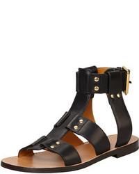 Sandalias planas de cuero con tachuelas negras