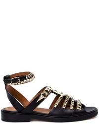Sandalias planas de cuero con tachuelas negras de Givenchy