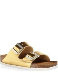 Sandalias planas de cuero doradas de Birkenstock
