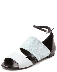 Sandalias planas de cuero en blanco y negro de MCQ