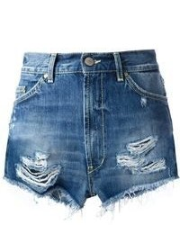 Pairing a light blue denim shirt with shorts is a comfortable option for running errands in the city.
