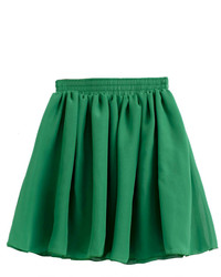 Wear dark green suede booties with a skater skirt for a Sunday lunch with friends.