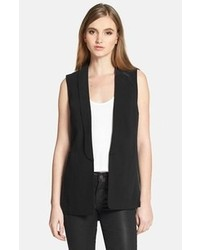 This combination of a black shift dress and a waistcoat is perfect for off-duty occasions.