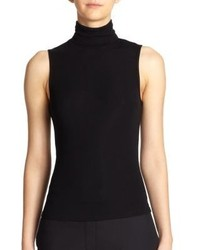 Rock slim trousers with a sleeveless turtleneck for a casual level of dress.