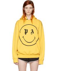 Sudadera con capucha estampada amarilla