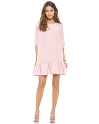 Opt for a long sleeve t-shirt and a swing dress for a glam and trendy getup.