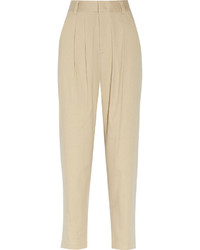 A beige cropped top and tapered pants will give off this very sexy and chic vibe.