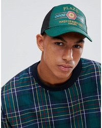 ASOS DESIGN Trucker In Green With Plaza Badge Detail