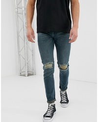 ASOS DESIGN Skinny Jeans In Green Cast With Knee Rips