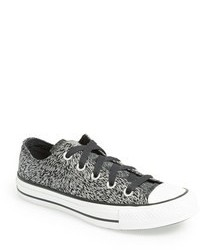 Tenis con print de serpiente grises de Converse