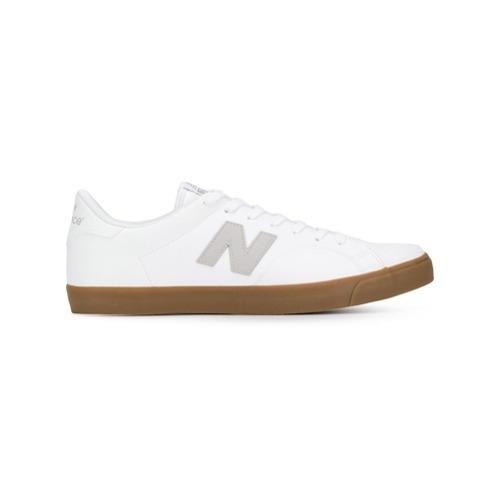 Tenis de cuero blancos de New Balance, MEX$2,665 | farfetch