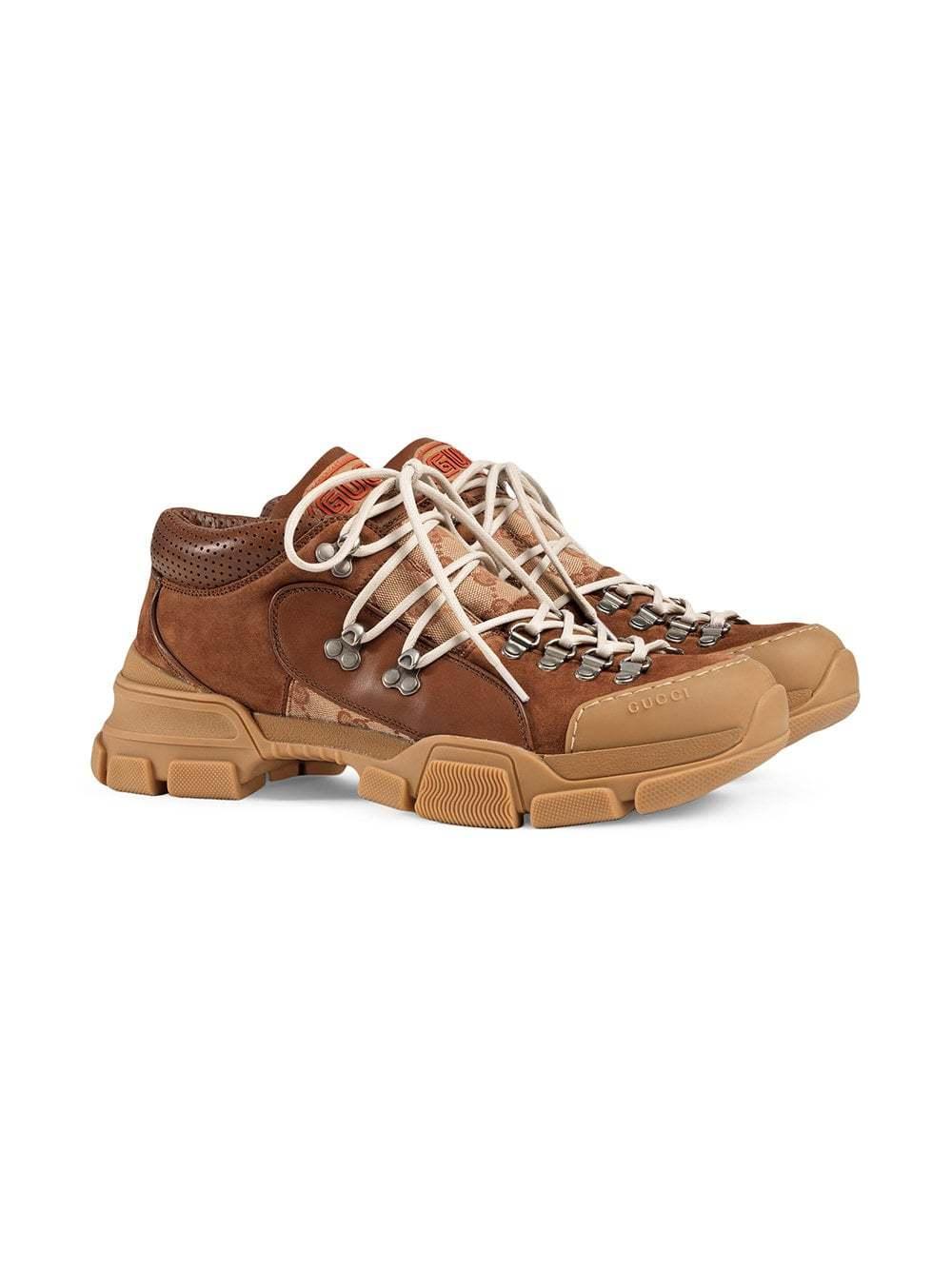 ba368f39d Gucci Leather And Original Gg Low Top Trekking Boot, $886 | farfetch.com |  Lookastic.com