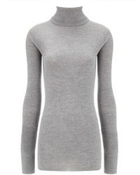 This combo of a grey knit open cardigan and a rollneck will attract attention for all the right reasons.
