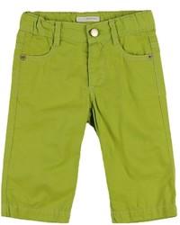 Vaqueros en amarillo verdoso