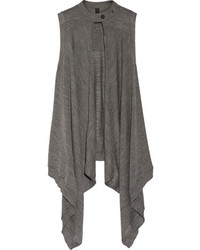 Marry a dark grey long sleeve t-shirt with a vest to create a chic, glamorous look.