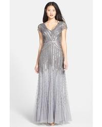 066d11baf Comprar un vestido de noche con adornos gris  elegir vestidos de ...