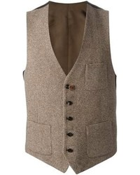 Dark brown leather work boots and a waistcoat are a great outfit formula to have in your arsenal.