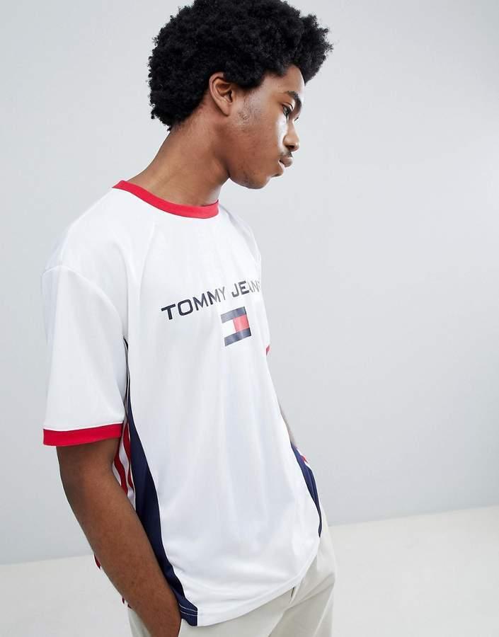 526cdcf3 ... Tommy Jeans 90s Sailing Capsule Flag Logo Ringer Soccer T Shirt Back  Logo Number In Whitenavyred ...